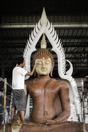 sculpting: Man sculpting Buddha statue