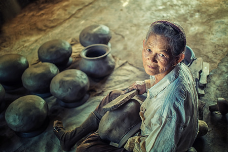 potter: Potter  making clay pot.