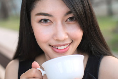 cute lady: Woman drinking coffee for relaxed.