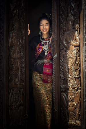 lineage: Asian woman in traditional dress. Beautiful woman dressed in silk.