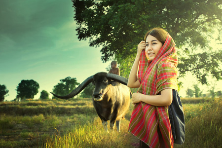 agriculturist: Asian Country Girl with buffalo in countryside. Stock Photo