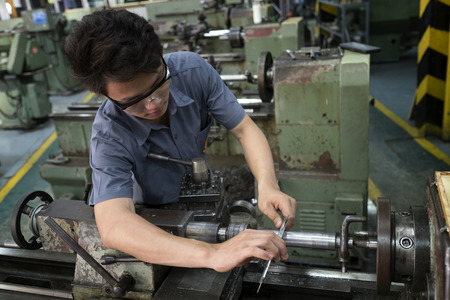 reefer: technician checking for workpiece steel on machine Stock Photo