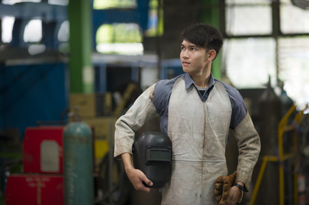 man in suite: Man wearing safety suite for working in steel industry Stock Photo