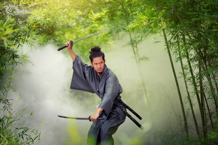 Japanese man in a samurai holding a katana sword