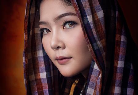 Asian woman wearing  local costume in studio. 版權商用圖片