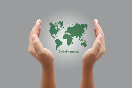Hands holding a green earth,global warming