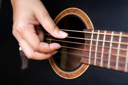 playing folk: Playing the Guitar Stock Photo
