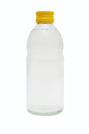 glass bottle on white background,Yellow bottle caps.  photo