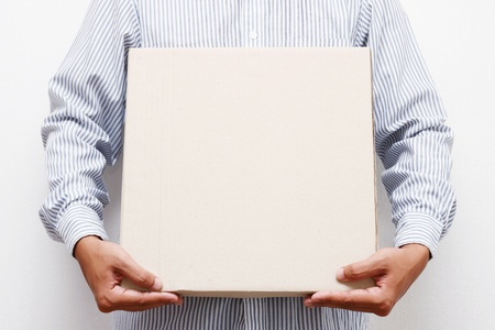 Man hold brown paper box Stock Photo