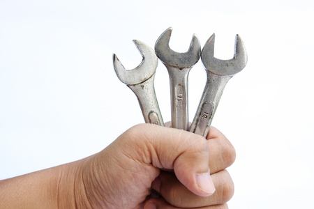Wrenches in hand on white background Stock Photo - 11387898