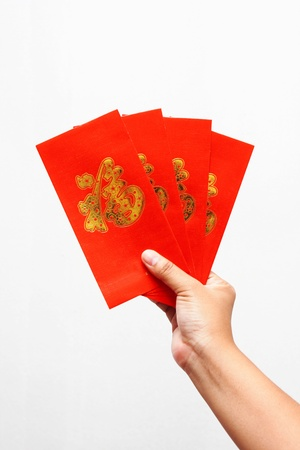 Hand holding Chines Red Envelope  Stock Photo