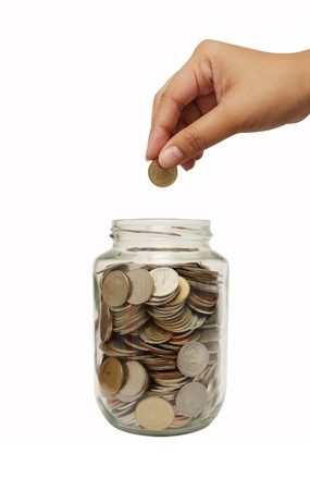 dime: coins dropping in glass jar