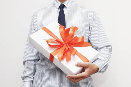 gift with red bow in hand  photo