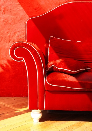 Red sofa with pillows included
