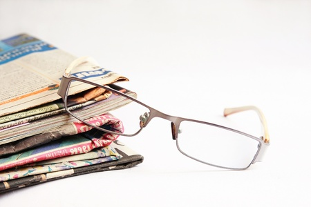 newspaper and glasses Stock Photo - 11793555