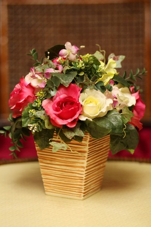 vase of flowers in wood room  photo