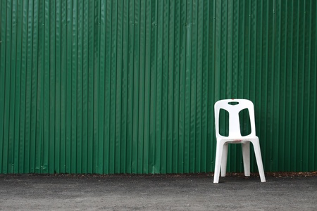 Green zinc and white chair photo
