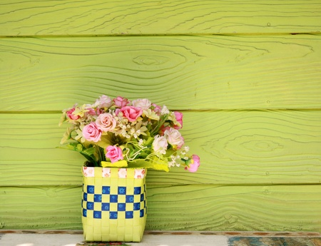 Plastic flowers and green wall photo