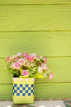 Plastic flowers and green wall Stock Photo - 12477378