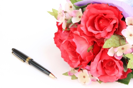 Plastic roses and pen,Fake roses photo