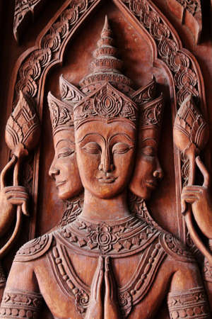 wood carving: The carved angel in Thai temple Stock Photo
