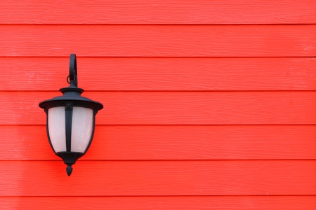 Vintage lamp and red wall  photo
