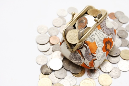 coins in purse on white background Stock Photo - 12989772