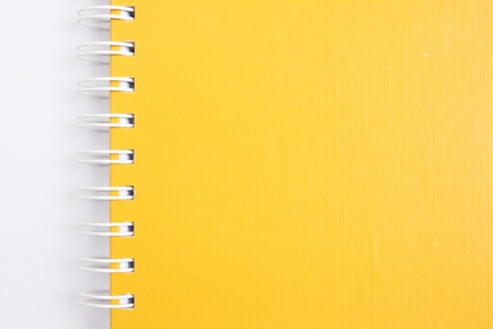 yellow notebook on white photo