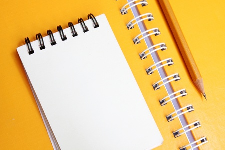 yellow Notebook with pencil