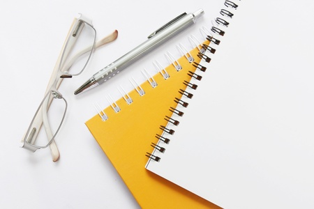 notebook glasses and pen on white  Stock Photo - 13866095