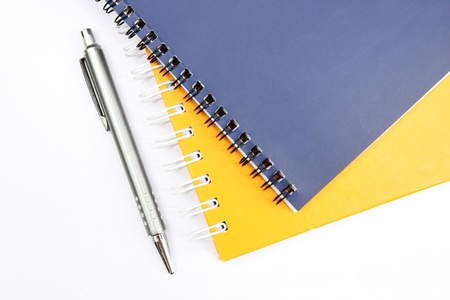 notebook with pen on white background  Stock Photo