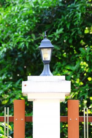 street lamp on Fence  photo
