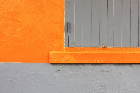 Window on orange cement wall photo