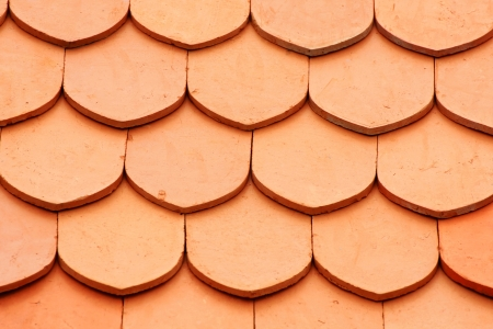 Detail of a house red roof tiles  photo
