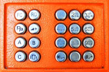 close up shot of orange phone keypad  photo