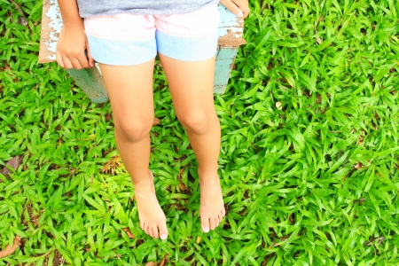 Legs and green grass  photo