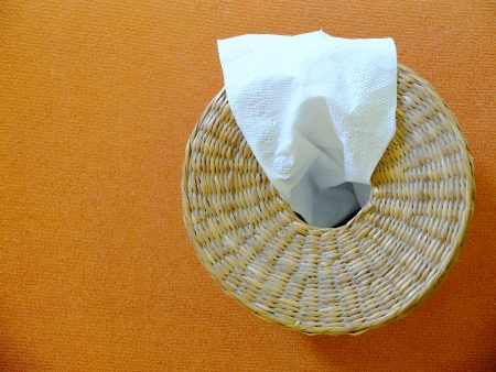 Tissue box on orange background
