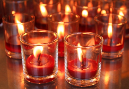 candles light the darkness in church