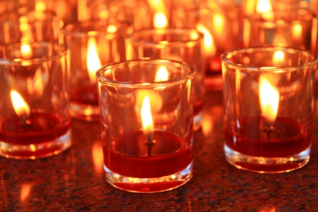 candles light the darkness in church photo
