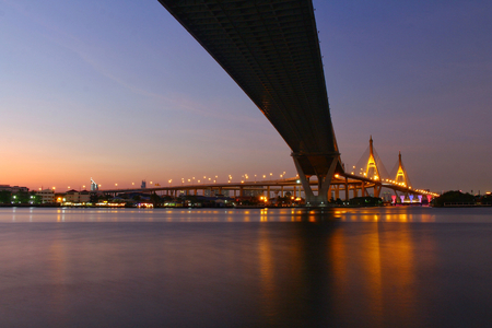 Ove Bhumibol Bridge On the banks of the Chao Phraya River at twilight in Thailand.