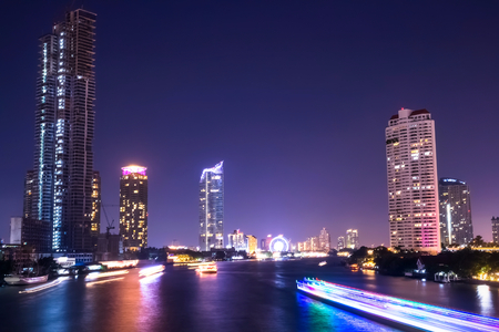 Cityscape at night,The center economic and business of Thailand on chao phraya river is the landmark of Bangkok and Asia. Stock Photo