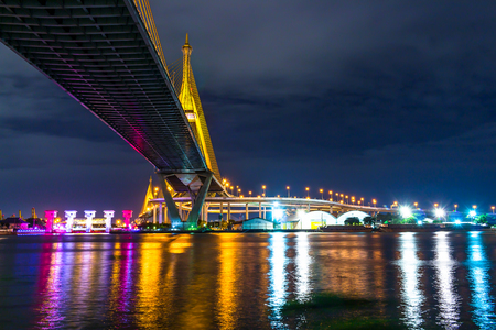 Bhumibol bridge in bangkok cityscape and landscape Chao Phraya River reflection water at night
