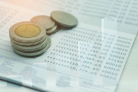 Bar graph coins statement book bank account of double exposure for finance and banking concept Archivio Fotografico