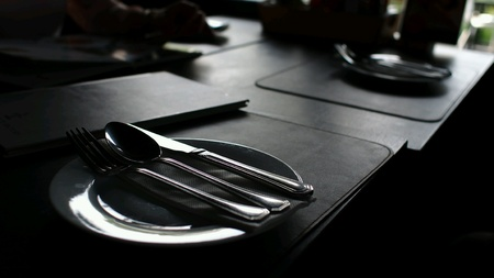 background: Plate Spoon Knife in the Dark