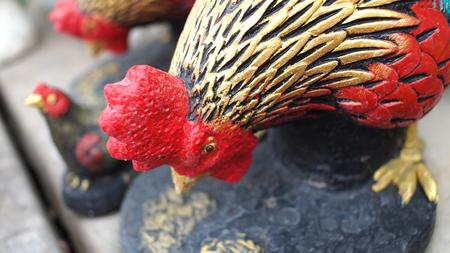 cockscomb: Chicken Family Cement Dolls Stock Photo