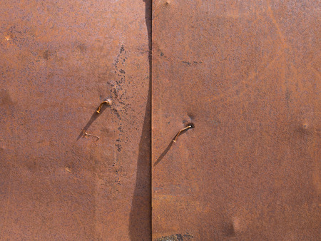 rusty nail: Nail Bent in a Rusty Steel Plate