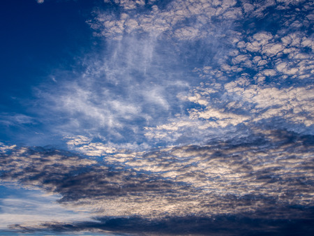 White Wavy Gray Clouds across The Sky Stock Photo