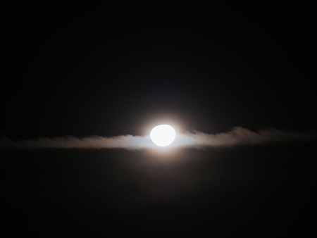 astrophysical: Moon Between The Cloud Line Stock Photo