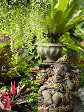 Ganesh Statue God of Immortality , Standing in The Garden Stock Photo