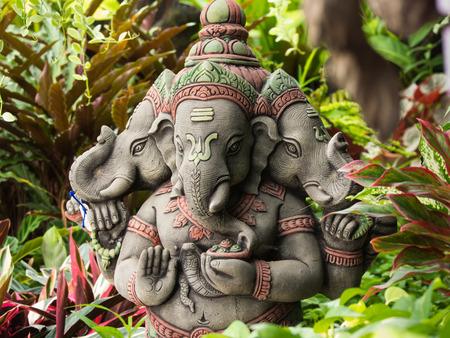 Stock Photo   Three Headed Deity Ganesh Statue, Standing In The Garden